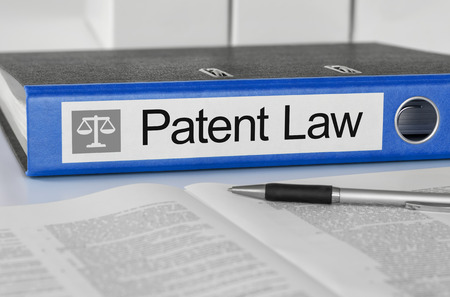 patent: Blue folder with the label Patent Law
