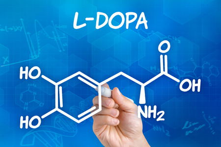 parkinsons: Hand with pen drawing the chemical formula of L-DOPA