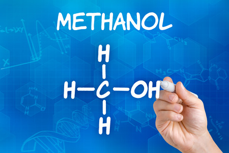 methyl: Hand with pen drawing the chemical formula of Methanol