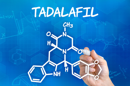 erectile dysfunction: Hand with pen drawing the chemical formula of Tadalafil Stock Photo