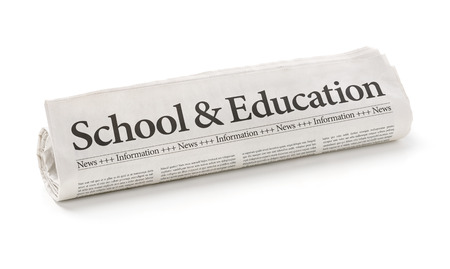 Rolled newspaper with the headline School and Education photo