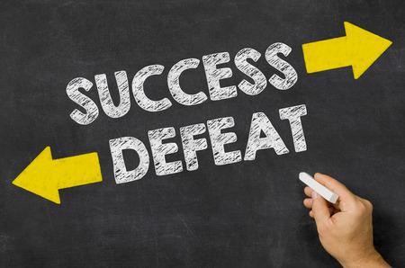 Success or Defeat written on a blackboard photo