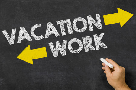 Vacation or Work written on a blackboard photo