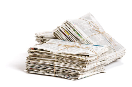 Some bundles of newspapers on a white background Foto de archivo