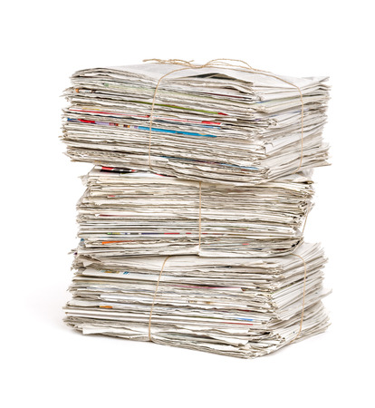 bundles: Stacked newspaper bundles on a white background