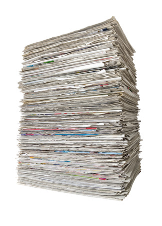 pile of newspapers: A pile of newspapers on a white background