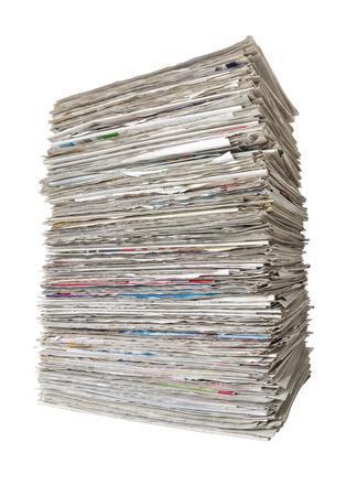 Una pila de periódicos sobre un fondo blanco Foto de archivo - 41476845