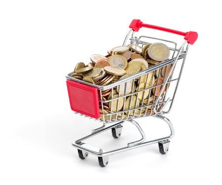 Shopping cart filled with euro coins on a white background