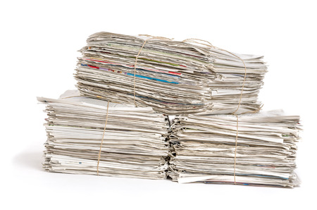 bundles: Bundles of newspapers on a white background Stock Photo