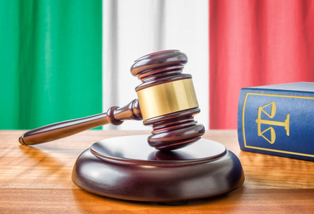 attorney: A gavel and a law book - Italy