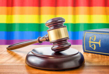 judges: A gavel and a law book - Rainbow flag Stock Photo