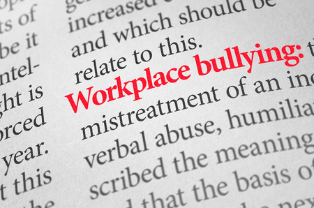 humiliation: Definition of the term Workplace bullying in a dictionary Stock Photo