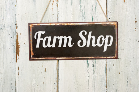 farm sign: Old metal sign in front of a white wooden wall - Farm Shop