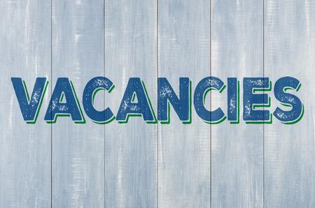 vacancies: Blue wooden wall with the inscription Vacancies
