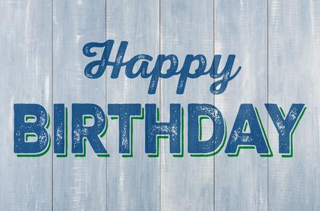 auguri di compleanno: parete di legno blu con la scritta Buon Compleanno