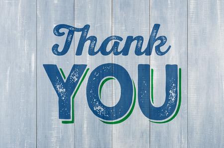 Modrá dřevěná stěna s nápisem Děkuji