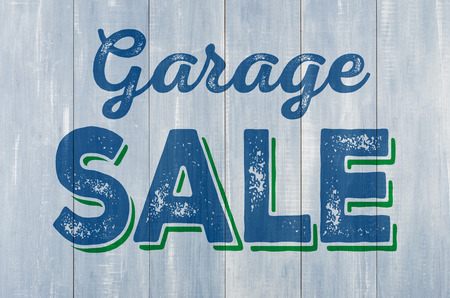 Blue wooden wall with the inscription Garage Sale 스톡 콘텐츠