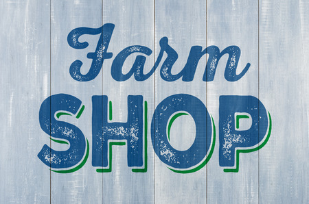 pared madera: Pared de madera azul con la inscripci�n Farm Shop Foto de archivo