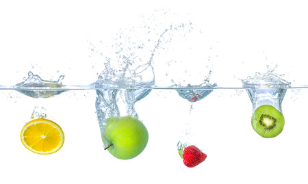 Fresh fruits falling into water with splashes