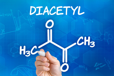 buttery: Hand with pen drawing the chemical formula of Diacetyl