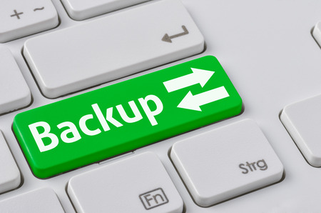 backups: A keyboard with a green button - Backup