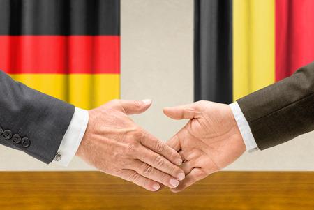 representatives: Representatives of Germany and Belgium shake hands