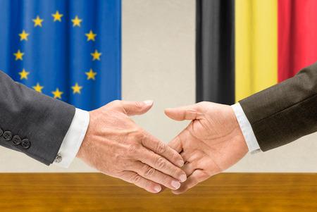 representatives: Representatives of the EU and Belgium shake hands Stock Photo