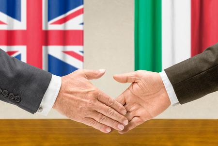 representatives: Representatives of the UK and Italy shake hands