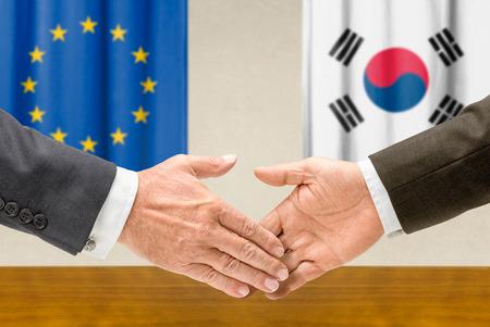 representatives: Representatives of the EU and South Korea shake hands