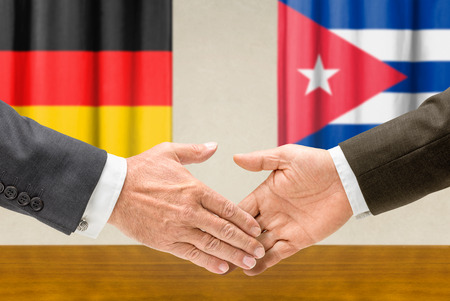 representatives: Representatives of Germany and Cuba shake hands