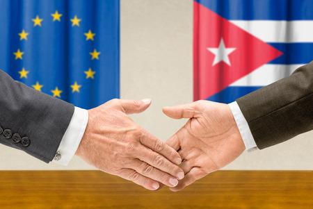 representatives: Representatives of the EU and Cuba shake hands