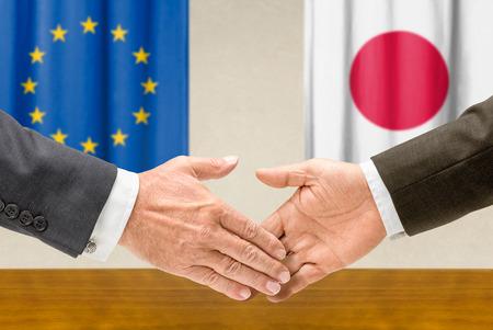 representatives: Representatives of the EU and Japan shake hands