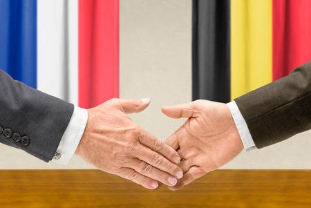 representatives: Representatives of France and Belgium shake hands