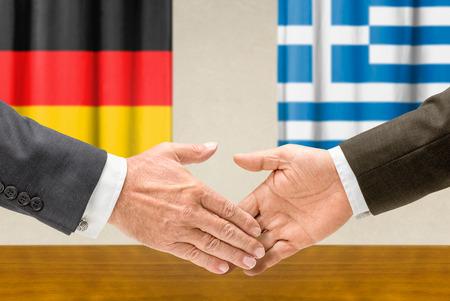 representatives: Representatives of Germany and Greece shake hands