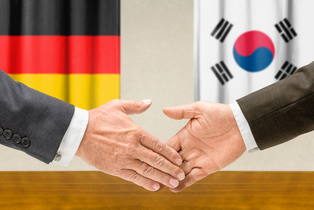 foreign nation: Representatives of Germany and South Korea shake hands Stock Photo