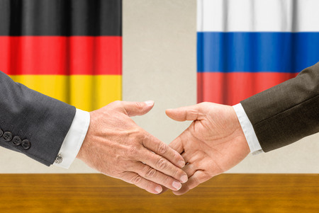 representatives: Representatives of Germany and Russia shake hands Stock Photo