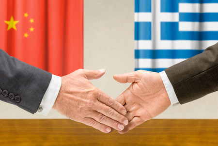Representatives of China and Greece shake hands