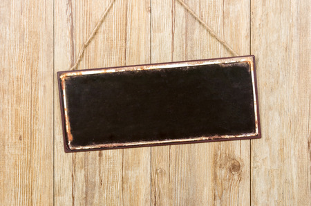 retro style: Empty metal sign on a wooden wall
