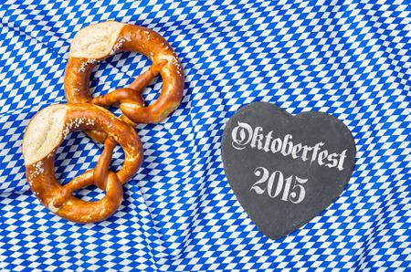 heartshaped: Heart-shaped blackboard with pretzels - Oktoberfest 2015 Stock Photo