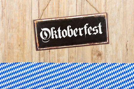 old sign: Old metal sign with the word Oktoberfest