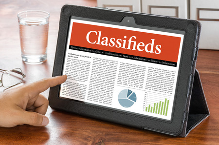 classifieds: A tablet computer on a desk - Classifieds