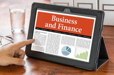 articles: A tablet computer on a desk - Business and Finance
