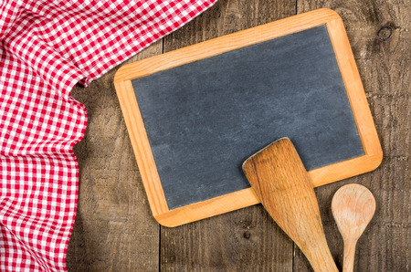 menue: Chalkboard and wooden spoons with a red checkered cloth