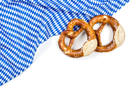 menue: White blue diamond pattern with two pretzels on a white background