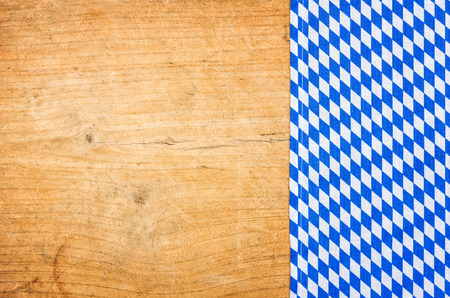 tablecloth: A wooden background with a bavarian tablecloth