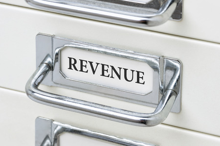 cardbox: A drawer cabinet with the label Revenue Stock Photo