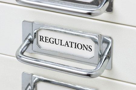 regulations: A drawer cabinet with the label Regulations