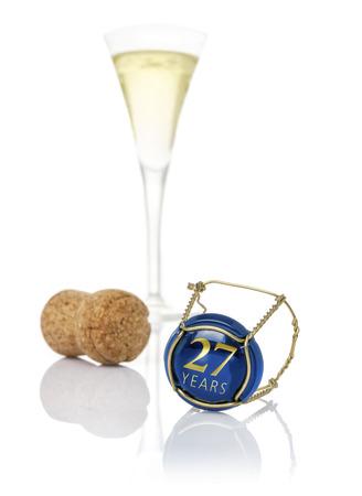 aniversario de boda: Tapa de Champagne con la inscripción de 27 años