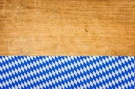 menue: Rustic wooden background with a bavarian tablecloth