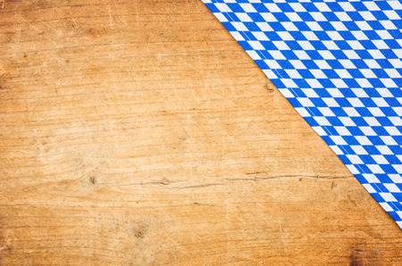 menue: A wooden background with a bavarian table cloth